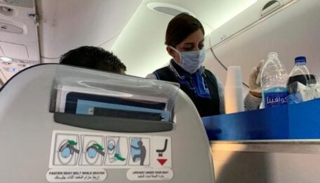 An EGYPTAIR flight crew member wears a protective mask following an outbreak of the coronavirus disease (COVID-19) during service on the flight from Cairo to Luxor