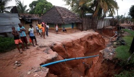 Residents look at a road that collapsed in the aftermath of Cyclone Kenneth, at Wimbe village in Pemba